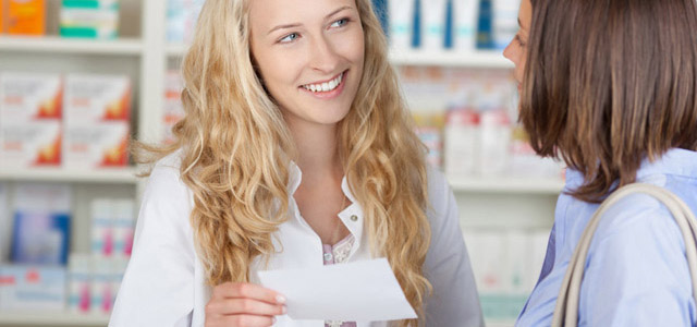 person receiving medication counseling from pharmacist