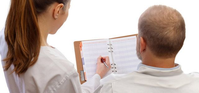 pharmacists reviewing medication history